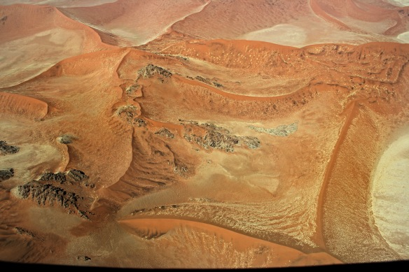 Strange formations of coloured sand and rock in the Namib Desert are only visible from the air