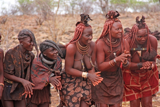 Himba women and girls dancing in traditional dress in Kunene, Namibia