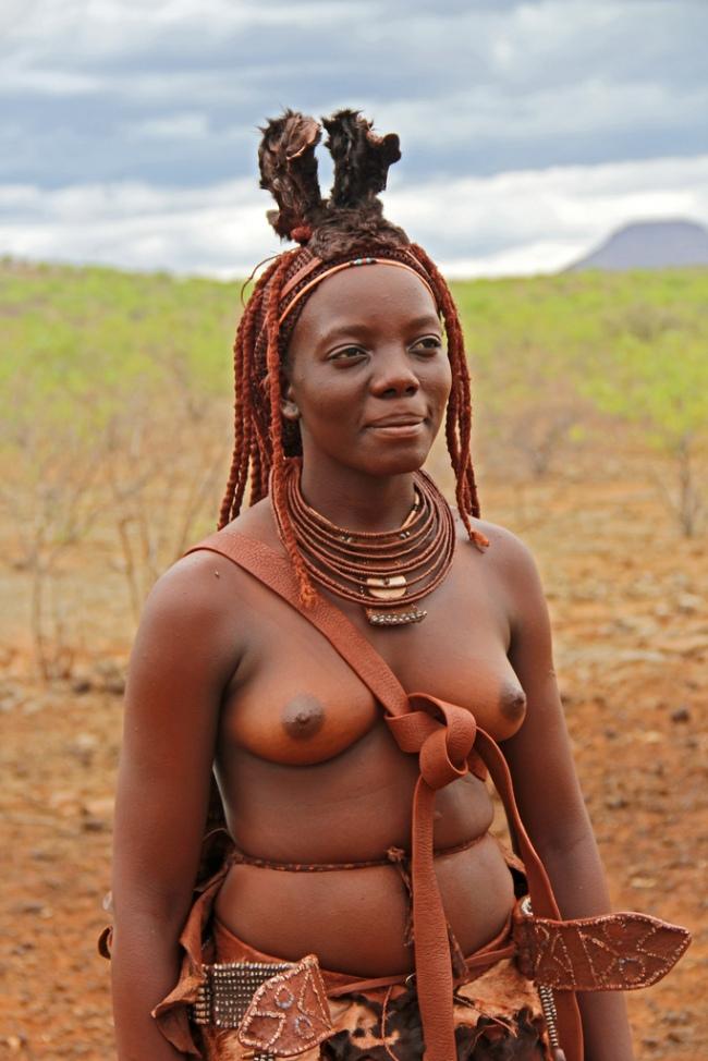 Young Himba woman in traditional dress in Kunene, Namibia