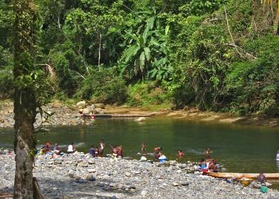 Afroecuadorian women doing laundry in the river, Esmeraldas, Ecuador