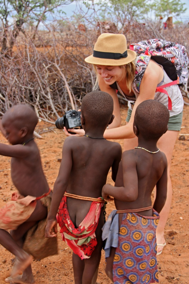 Himba kids in Namibia look at digital photos of themselves
