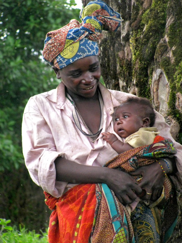 Batwa mother and baby in Mgahinga Gorilla National Park, Uganda