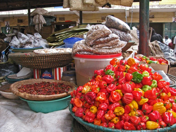 Food stall in Owino market, Kampala, Uganda. Scotch bonnet peppers, chilli, baskets, Africa