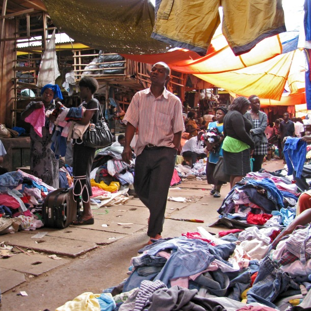 Chaos in Owino market, Kampala, Uganda. Clothes stalls in Africa.
