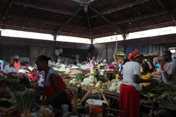 Caribbean food market in Cap Haitian, Haiti. Traders sell fruit and veg.