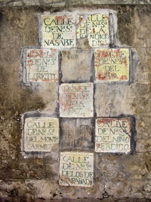 Old stone street signs in Cartagena, Colombia