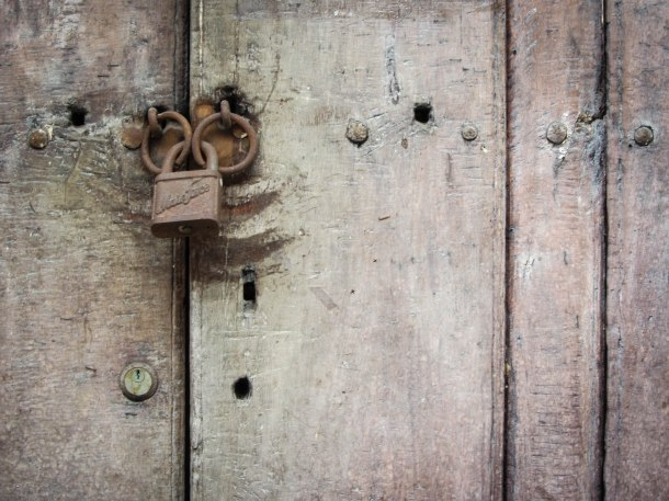 A padlock on heavy old wooden doors, Cartagena, Colombia