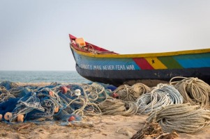 """Capacity man never fear war"" - fishing boat in Ghana"
